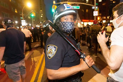 NEW YORK - May 30, 2020: for NEWS. A police officer with an American flag mask at Union Square as riots broke out against the NYPD in Manhattan after protests against the police involved death of George Floyd in Minneapolis turned violent amid the COVID-19 coronavirus pandemic.  nypostinhouse (Photo by: Taidgh Barron/NY Post)