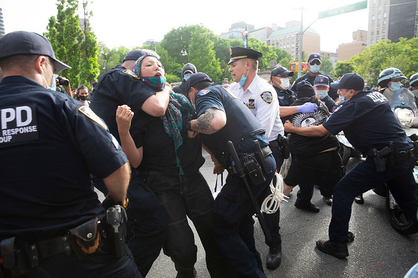 NEW YORK - May 28, 2020: for NEWS. A police officer puts a protester into a chokehold after dozens of anti-police protesters were arrested by the NYPD Strategic Response Group amid protests against the police involved death of George Floyd in Minneapolis amid the COVID-19 coronavirus pandemic.  nypostinhouse (Photo by: Taidgh Barron/NY Post)
