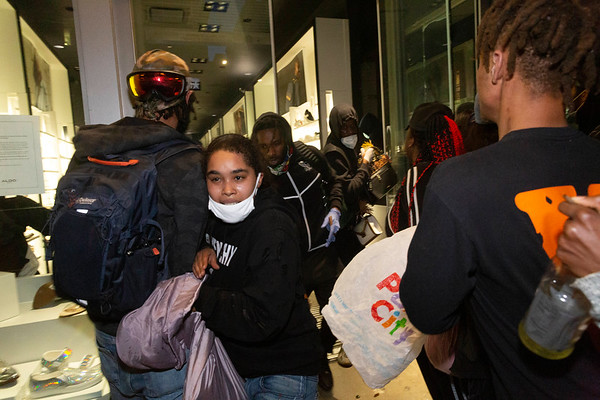 NEW YORK - June 1, 2020: for NEWS. Looters  carrying sacks of stollen merchandise after a mob hit every storefront on 5th Avenue in Midtown South using protests against police involved death of George Floyd in Minneapolis as a guise to loot amid the COVID-19 coronavirus pandemic.  nypostinhouse (Photo by: Taidgh Barron/NY Post)