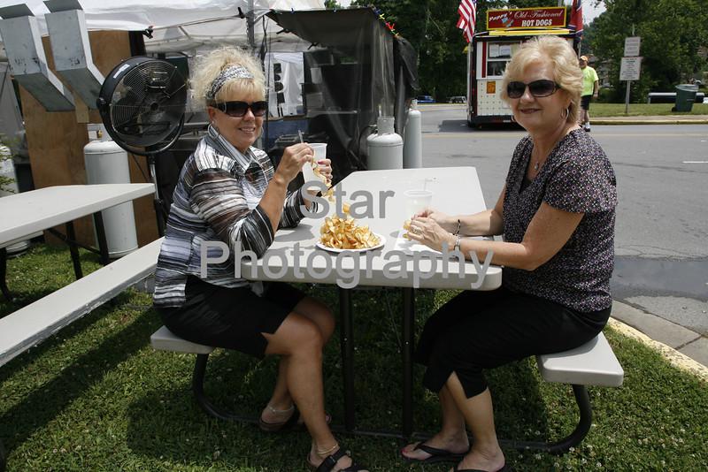 Photo by Eveleigh Stewart <br /> Cindy Camper and Sandra Richardson enjoy a crazy potato