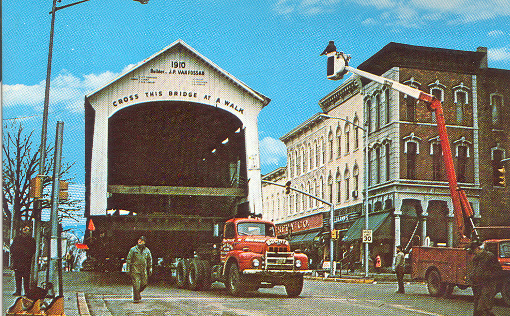 Jessup Bridge, Parke County, Indiana.  The photo shows bridge as it was being moved through Rockville.  Bridge replaced the Adams Bridge which was destroyed in the flood of 1969.