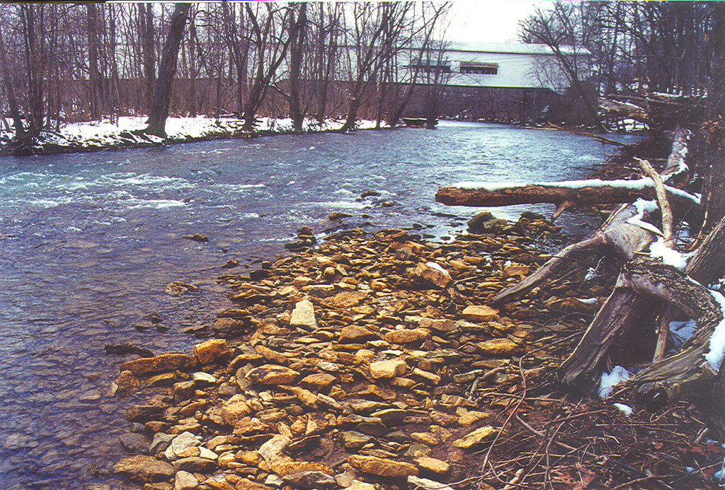 Moscow Covered Bridge, Rush County, Indiana.  Photographed in 1991.<br /> updated: 6/4/2008 1:23:00 PM<br /> [UPDATED] Storm Devastates Rush County Community<br /> InsideINdianaBusiness.com Report<br /> Moscow resident Brian Colestock says his home was damaged by the powerful storm. Residents and business owners in several Indiana counties are assessing damage caused by powerful storms that roared through much of the state last night. Our partners at Network Indiana./WIBC report the town of Moscow in Rush County was nearly blown off the map. The state's longest covered bridge has been destroyed. It spanned the Flat Rock River.<br /> <br /> Source: Inside Indiana Business<br /> <br /> Followup June 2010:  Great news...the Moscow Covered Bridge has been rebuilt!!  I hope to get photo's of the new bridge soon.