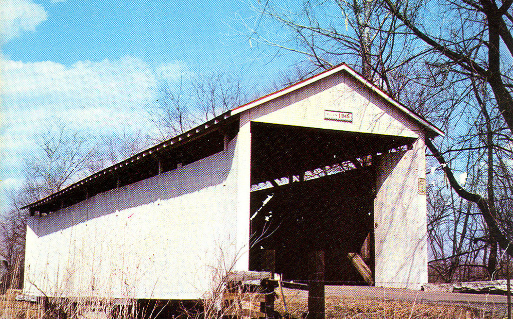 Irishman's Covered Bridge, Vigo County, Indiana.  This postcard view shows the bridge at its original location near Riley, Indiana over Honey Creek.