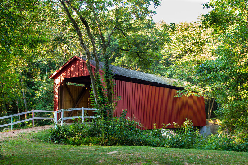 Sandy Creek Covered Bridge. Originally built in 1872 by John H. Morse for $2000, it was flooded and destroyed in 1886 and rebuilt by Henry Steffin for $899 by reusing half of the original timbers and original abutments.  The bridge is 74.5-foot (22.7 m), 18 feet 10 inches (5.7 m) wide and an height of 13-foot (4.0 m).