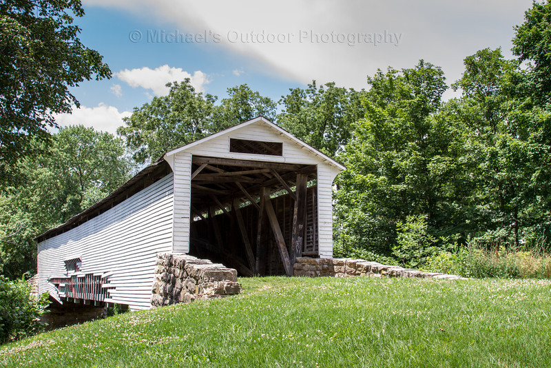 Union Covered Bridge near Paris Missouri and spans the Elk Fork of the Salt River. Built in 1871, this is the last covered bridge that utilized the  Burr-arch truss design. The bridge is 120 feet long, 17 1/2 feet wide and it has an entrance of 12 feet high.