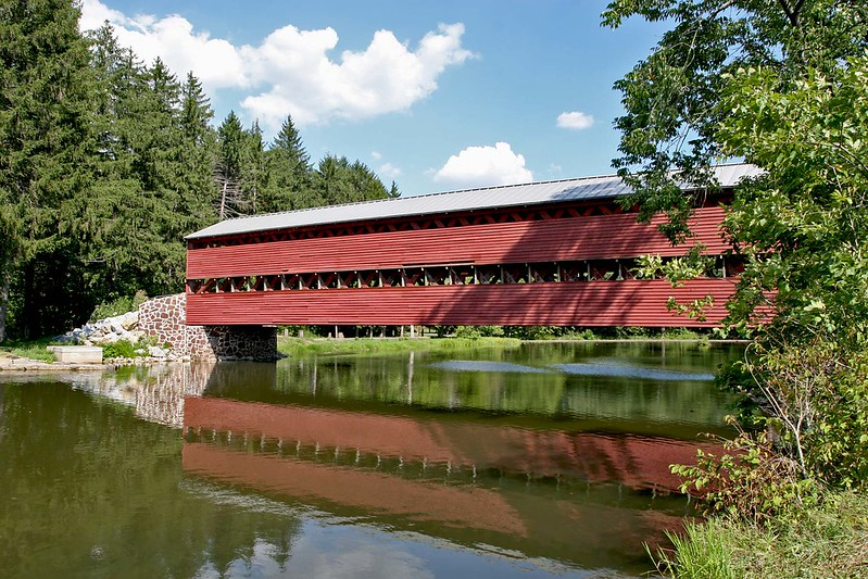 Saucks Covered Bridge was built in 1854 and is located by Gettysbrug National Military Park in PA.<br /> The bridge is 100' long and 15' wide. One span using the Town truss design. Only open to foot traffic.<br /> The covered bridge is known for it's beauty, history and quiet location. The Sauck's Covered Bridge is<br />  also a favorite of ghost hunters. The bridge is known to have been the site of a triple hanging at one end,<br /> and close to a crude post battle field hospital.