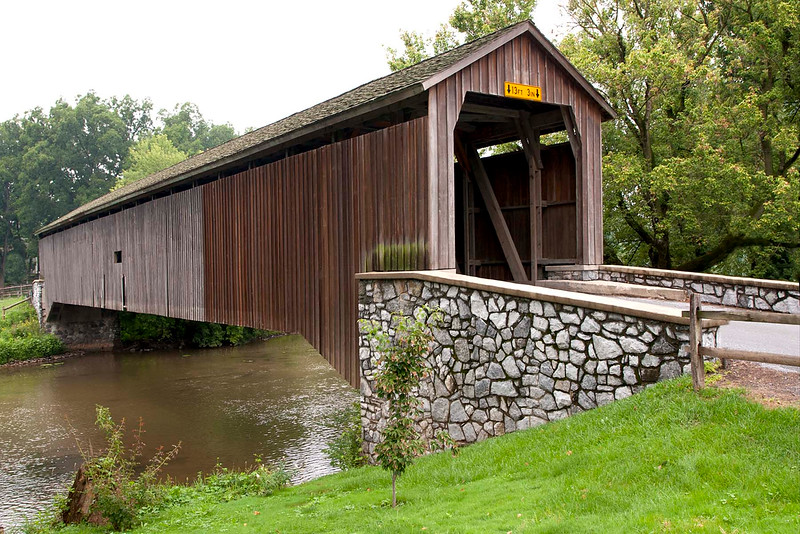 The Hunsecker Mill covered Bridge originally built in 1848 but was destroyed by Hurricane Agnes.<br />  In 1972 the PADOT replaced it. 180' long. located in Lancaster County. PA