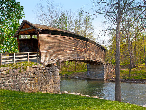 Humpback Covered Bridge is Virginia's oldest standing covered bridge. The 100 ft. long, single span structure is  four feet higher at the center than it is at either end. Built in 1857 and was in use until 1929. It was used by a  nearby farmer to store hay until 1954. in 1954 it was restored and preserved where it stand today.  (west of Covington, Virginia)