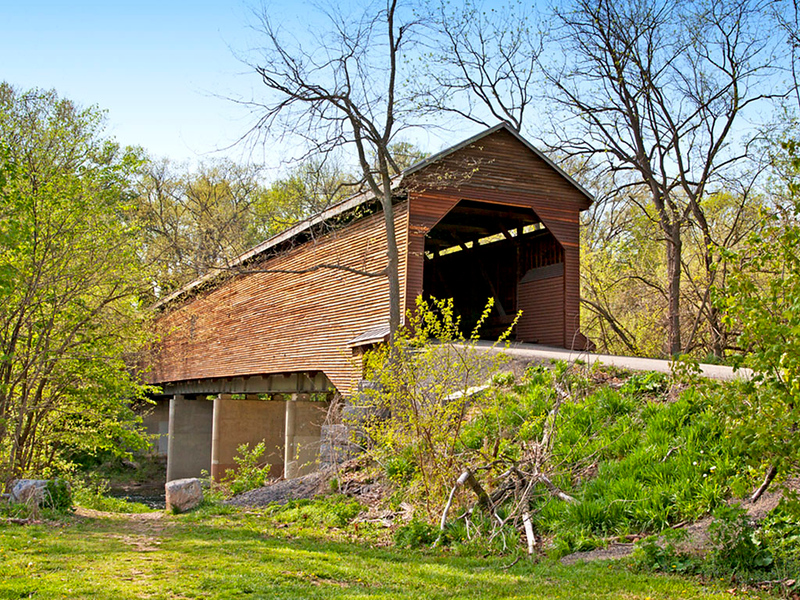 Meem's Bottom 204-foot single-span Burr arch truss Covered bridge. In Shenandoah County, Virginia. Built in 1894 <br /> from materials cut and quarried near bridge site. Burned by vandals on Halloween 1976. The original timbers were <br /> salvaged and the bridge was reconstructed and eventually undergirded with steel beams and concrete piers.