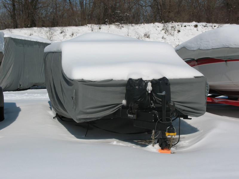 The PUP covered by the snow storm of March 2008.  Note that my neightbours boats as well as a Motorhome are now all covered.