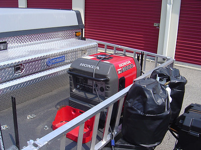 When covered, water would accumulate in the area between the tool box & the generator as well as between the generator and the side rails.  Hence I needed some type of support to prevent this from happening.