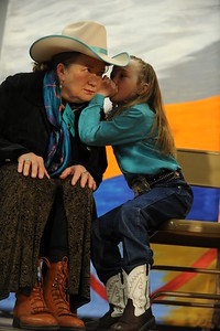 Cora Wood, right whispers in Liz Masterson's ear onstage during a yodelling workshop at the 26th annual National Cowboy Poetry Gathering, Elko, Nevada. January 29, 2010. Wood is the youngest performer at this yea's gathering