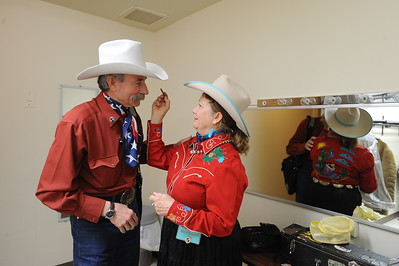 Baxter Black and Liz Masterson backstage berfore their performances. Scenes from the 26th Annual National Cowboy Poetry Gathering, Elko, Nevada. January 30, 2010.