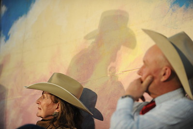 Yvonne Hollenbeck and Rodney Nelson watch from onstage during a round robyn of performers at the 26th annual National Cowboy Poetry Gathering, Elko, Nevada. January 30, 2010.