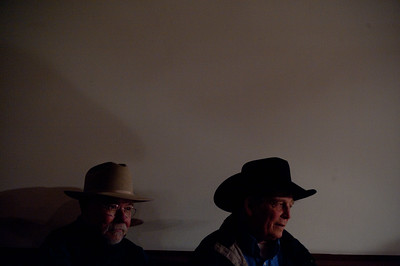 Charlie Seemann, left and Pat Richardson alongside the stage while Glenn Ohrlin performs at the G Three Bar Theater  Scenes from the 28th annual National Cowboy Poetry Gathering in Elko Nevada. February 2, 2012.