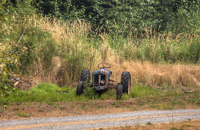 Tractor In A Field - Vancouver Island, British Columbia, Canada