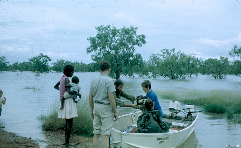 1969 Taking child to hospital during wet season