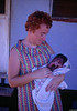 1968 Shirley Cox at early Mission bough shed medical clinic with baby born at mission camp