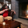 NoLo Bistro & Bar at The Stonehedge Inn & Spa in Tyngsboro has a nice atmosphere with a fire place in the center of the room to cozy up to this winter. Chris Leen of Bath Maine enjoys Daniel Webster Mule drink and the warmth of the fire recently at the bistro. SUN/JOHN LOVE