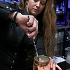 NoLo Bistro & Bar at The Stonehedge Inn & Spa in Tyngsboro has a nice atmosphere and a fire place in the center of the room to cozy up to this winter. Head Bartender Amanda Rankin prepares one of their signature drinks. SUN/JOHN LOVE