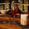 Cozy bars: The Outlook restaurant at Nashoba Valley Ski Area. From left, Candy Cane Martini, Mistletoe Punch, and Caramel White Russian. (SUN/Julia Malakie)