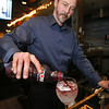 Cozy bars: The Outlook restaurant at Nashoba Valley Ski Area. Rick Buchanan makes a Mistletoe Punch. (SUN/Julia Malakie)