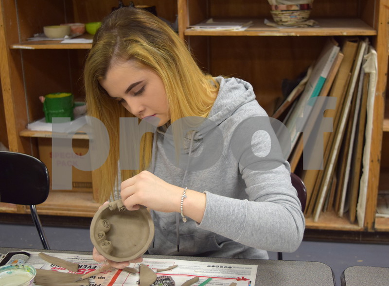 Sycamore High School freshman Brianna Gierke works on a bowl designed with roses during art class on Feb. 24. The bowls were created as part of the Empty Bowls Project and will be sold during an event April 19 to raise money for the Sycamore Food Pantry.