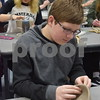 Sycamore High School freshman Jake Suddeth uses a loop tool to create a bowl with the Chicago Cubs design with baseball stitching during his art class on Feb. 24. Suddeth's bowl and other bowls created by Sycamore High School students and faculty will be sold for $10 each during an event April 19 to raise money for the Sycamore Food Pantry.