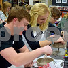 Sycamore High School senior Austin Mereness (left) and junior Ellie Kerkove work on their clay bowls during art class on Feb. 24. The bowls will be sold during an event on April 19 to raise money for the Sycamore Food Pantry.