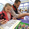 Emilia Krans, 4, colors a paper mail bag she made during craft time at the Leominster library on Friday morning, December 29, 2018 as her dad puts together a color-me puzzle. SENTINEL & ENTERPRISE/JOHN LOVE