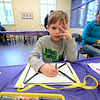 Whitney Conchieri, 5, colors a paper mail bag he made during craft time at the Leominster library on Friday morning, December 29, 2018. SENTINEL & ENTERPRISE/JOHN LOVE