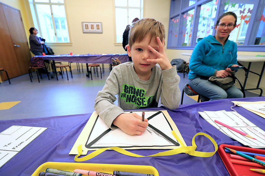 . Whitney Conchieri, 5, colors a paper mail bag he made during craft time at the Leominster library on Friday morning, December 29, 2018. SENTINEL & ENTERPRISE/JOHN LOVE
