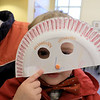Isaiah Krans, 2, show off the paper plate mask he made and decorated during craft time at the Leominster library on Friday morning, December 29, 2018. SENTINEL & ENTERPRISE/JOHN LOVE