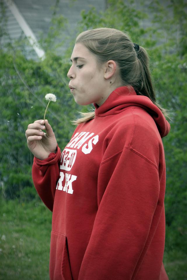 0421 Blowing a dandelion!