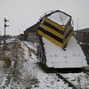 Snowplough ZZA ADB 965211 is seen by the level crossing at March with 66730 in the background on 19th Jan 2013