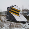 Snowplough ZZA ADB 965211 is seen by the level crossing at March on 19th Jan 2013