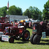 NASHOBA VALLEY VOICE/ANNE O'CONNOR<br /> Crank Up, a show with engines, tractors and much else, has been in Pepperell every summer since 1975. Charles Zaher of Chelmsford brought a few of his restored tractors to the meet. He also has tractors for working the land back home.