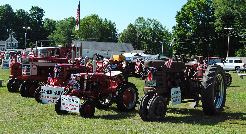 . NASHOBA VALLEY VOICE/ANNE O\'CONNOR Crank Up, a show with engines, tractors and much else, has been in Pepperell every summer since 1975. Charles Zaher of Chelmsford brought a few of his restored tractors to the meet. He also has tractors for working the land back home.