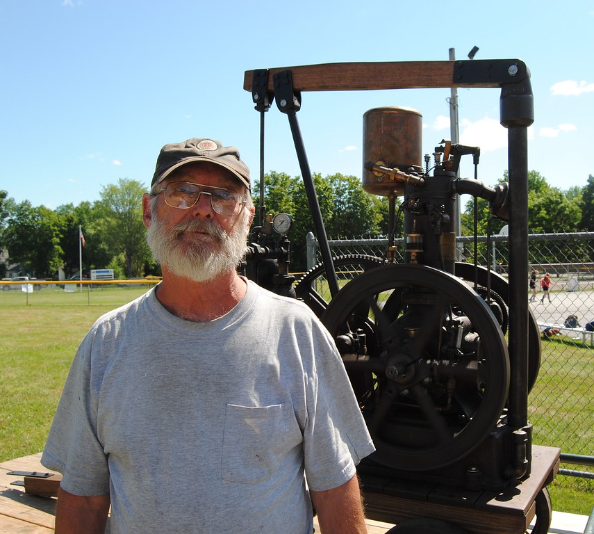 . NASHOBA VALLEY VOICE/ANNE O\'CONNOR Crank Up, a show with engines, tractors and much else, has been in Pepperell every summer since 1975. Dave Harper, a retired shop teacher living in Plympton, Mass. brought along his working 1917 Fairbanks and Morse domestic water pump.