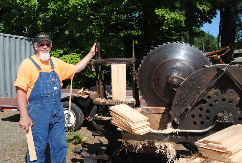 NASHOBA VALLEY VOICE/ANNE O'CONNOR<br /> Crank Up, a show with engines, tractors and much else, has been in Pepperell every summer since 1975. Usually Jim Coomey of Tewksbury has a younger partner to help demonstrate this shingle mill, built in Orange, Mass. in 1889. But not this time, due to the arrival of a new baby.