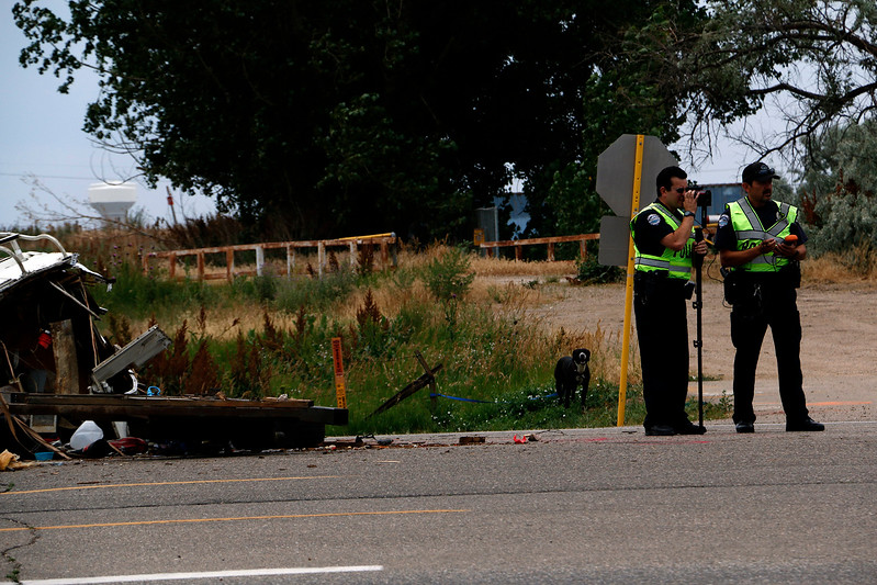 Loveland Police Department document an accident on Eisenhower Blvd. and Larimer Parkway on Friday, July 7, 2017. The collision involved two cars, a recreation vehichle and an SUV, with a total of eight people. (Michelle Risinger/ Loveland Reporter-Herald)