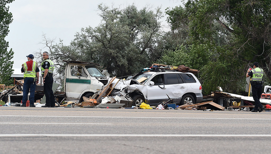 . Loveland Police investigate an accident Friday, July 7. 2017, between a recreational vehicle and a small SUV on U.S. 34 and Larimer Parkway near 25/34 in Loveland. Eight people were transported to the hospital with injuries and west bound U.S. 34 was closed. (Photo by Jenny Sparks/Loveland Reporter-Herald)