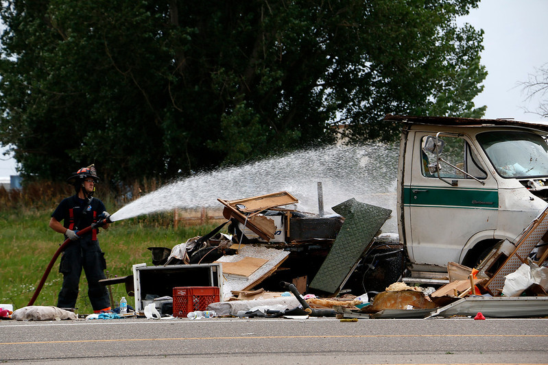 Loveland Fire Rescue Authority comes back for a second time to the accident on Highway 34 and Larimer Parkway in Loveland on Friday, July 7, 2017. (Michelle Risinger/ Loveland Reporter-Herald)