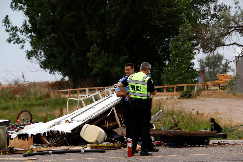 Loveland Police and Loveland Humane Society work together after a collision on Highway 34 and Larimer Parkway on Friday, July 7, 2017. (Michelle Risinger/ Loveland Reporter-Herald)