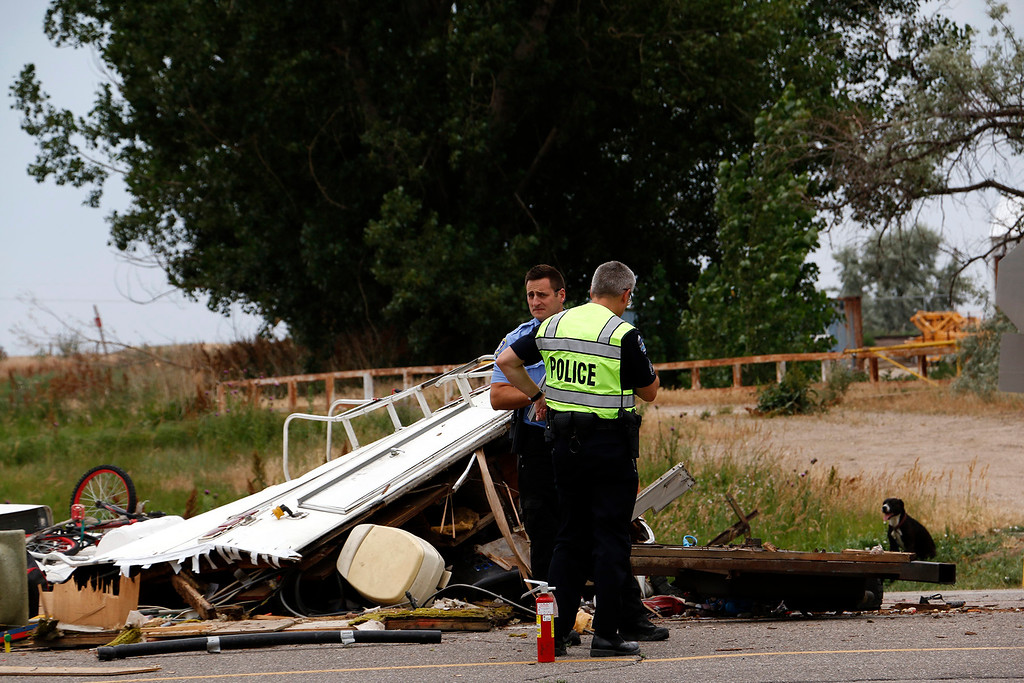 . Loveland Police and Loveland Humane Society work together after a collision on Highway 34 and Larimer Parkway on Friday, July 7, 2017. (Michelle Risinger/ Loveland Reporter-Herald)