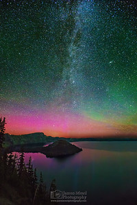 """Glimmering Waters,"" The Aurora Borealis, Andromeda Galaxy and Milky Way over Wizard Island and Fumarole Bay, Crater Lake National Park"
