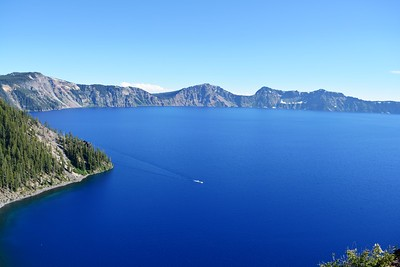 Crater Lake from East Shore Drive with tour boat in the distance