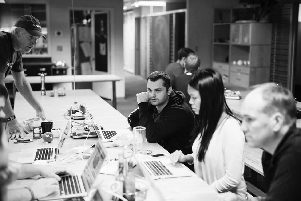 7 days until launch. Design Director Vilen Rodeski consults with Director of Marketing Denise Gamboa. Pictured L-R: Chris MacAskill, Vilen Rodeski, Denise Gamboa, Alastair Jolly.