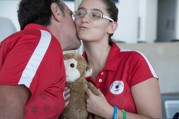 Gibraltar -  18th July 2014 - One of the young sportspeople heading for the Glasgow Commonwealth Games holding their own Team Gibraltar mascot as she greets another member of the team. Team Gibraltar, as they call themselves, will be participating in the Glasgow Commonwealth Games with its largest contigency to a games yet.