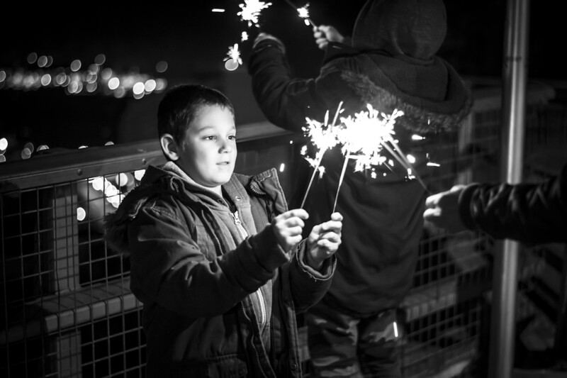 Images of a family celebrating the coming of the New Year 2014 in Gibraltar. Children playing with sparklers whilst they await the main fireworks display which took place at Casemates Square and could be seen across most of the main upper town area.